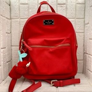 Kate Spade red nylon backpack with cherry keychain